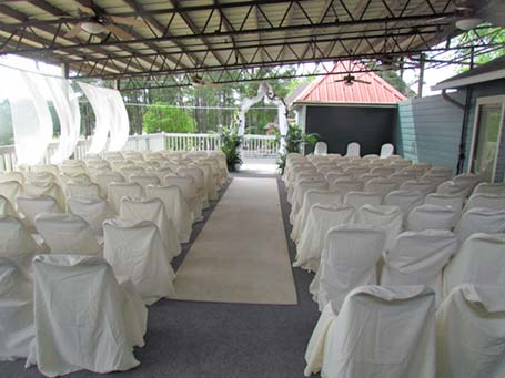 Photo of the upper deck set up for a wedding ceremony